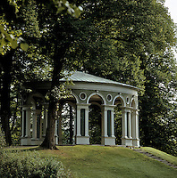 """The trellis-covered """"Salon de Treillage"""", also known as the Echo Temple, was once used as a summer dining room and affords wonderful views over the park"""