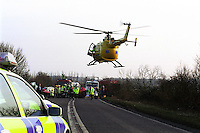 Firefighters, doctors, police and paramedics awaiting the air ambulance helicopter to land so as they can load a casualty from a road traffic accident to be taken to hospital. ..© SHOUT. THIS PICTURE MUST ONLY BE USED TO ILLUSTRATE THE EMERGENCY SERVICES IN A POSITIVE MANNER. CONTACT JOHN CALLAN. Exact date unknown.john@shoutpictures.com.www.shoutpictures.com...