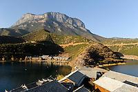 CHINA Province Yunnan, Lugu Lake, Mosuo village and peninsula with lodges and restaurants /CHINA Provinz Yunnan , Lugu See, Mosuo Dorf und Halbinsel mit Hotels and Restaurants