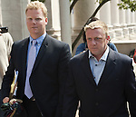 NEW HAVEN, CT-26 JULY 2012--072612JS01- Paul Rogers, right, makes his way out of New Haven Federal Court on Thursday after pleading not guilty as part of an indictment to funnel illegal campaign donations to Chris Donovan's former campaign manager. <br />Jim Shannon Republican-American