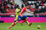 Diego Costa (R) of Atletico de Madrid fights for the ball with Dakonam Ortega Djene of Getafe CF during the La Liga 2017-18 match between Atletico de Madrid and Getafe CF at Wanda Metropolitano on January 06 2018 in Madrid, Spain. Photo by Diego Gonzalez / Power Sport Images