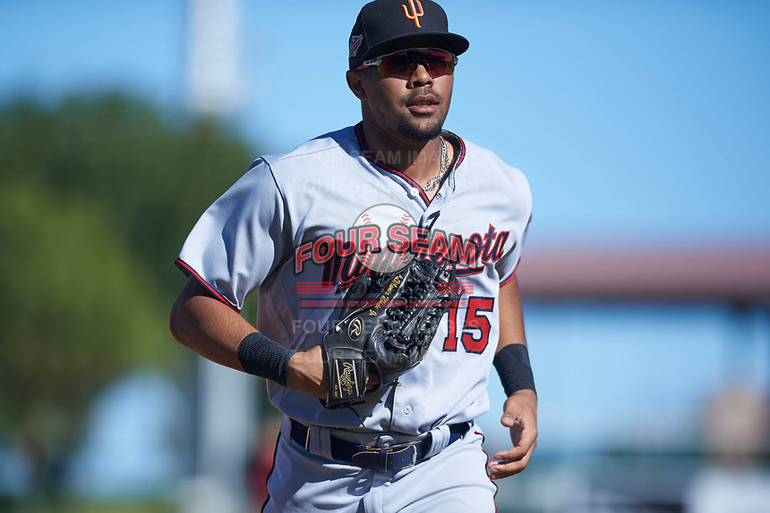 Surprise Saguaros right fielder LaMonte Wade (15), of the Minnesota Twins organization, jogs off the field between innings of an Arizona Fall League game against the Scottsdale Scorpions on October 27, 2017 at Scottsdale Stadium in Scottsdale, Arizona. The Scorpions defeated the Saguaros 6-5. (Zachary Lucy/Four Seam Images)