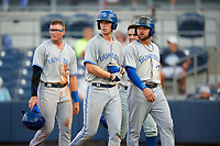 Dunedin Blue Jays Kacy Clemens (left), Riley Adams (center), Bradley Jones (right), and Nash Knight (background) walk to the dugout after a grand slam by Adams in the top of the fourth inning during a game against the Charlotte Stone Crabs on June 5, 2018 at Charlotte Sports Park in Port Charlotte, Florida.  Dunedin defeated Charlotte 9-5.  (Mike Janes/Four Seam Images)