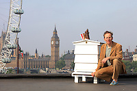 Mikey Tomkins posing in front of a hive at the Royal Festival Hall. The apiary on the roof of the Royal Festival Hall was launched in 2008 by Mikey and Andrew Hinton with John Chapple from the London Beekeeping Association. Mikey Tomkins, beekeeper and researcher in urban planning, works for Capital Growth. Capital Growth is a partnership between London Food Link, the mayor of London, Boris Johnson, and the Big Lottery's Local Food Fund. The campaign is part of a program that aims at creating 2012 new community vegetable gardens in London by the end of 2012.
