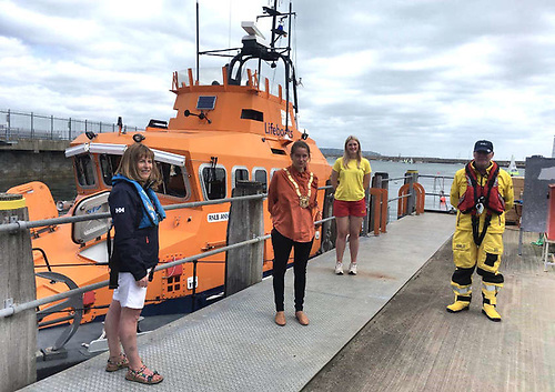 An Cathaoirleach of DLRCoCo, Cllr Una Power pictured with Dun Laoghaire RNLI volunteers