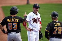 Minnesota Twins third baseman Josh Donaldson (20) talks with Tony Wolters (93) and coach Joey Cora (28) during a Major League Spring Training game against the Pittsburgh Pirates on March 16, 2021 at Hammond Stadium in Fort Myers, Florida.  (Mike Janes/Four Seam Images)
