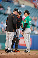 Norfolk Tides pitching coach Mike Griffin (left) talks with relief pitcher Zach Muckenhirn (52) and catcher Austin Wynns (19) during an International League game against the Buffalo Bisons on June 22, 2019 at Sahlen Field in Buffalo, New York.  Buffalo defeated Norfolk 3-0.  (Mike Janes/Four Seam Images)