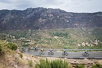 peloton up the first categorised climb of the day: the Puerto de Bernardo<br /> <br /> Stage 20: Arenas de San Pedro to Plataforma de Gredos (190km)<br /> La Vuelta 2019<br /> <br /> ©kramon