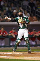 Charlotte 49ers catcher Derek Fritz (26) makes a throw to first base against the Georgia Bulldogs at BB&T Ballpark on March 8, 2016 in Charlotte, North Carolina. The 49ers defeated the Bulldogs 15-4. (Brian Westerholt/Four Seam Images)
