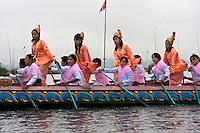 Myanmar, Burma.  Burmese Women Dancers on Boat in Buddhist Ceremony, Alodaw Pauk Pagoda, Nampan Village, Inle Lake, Shan State.