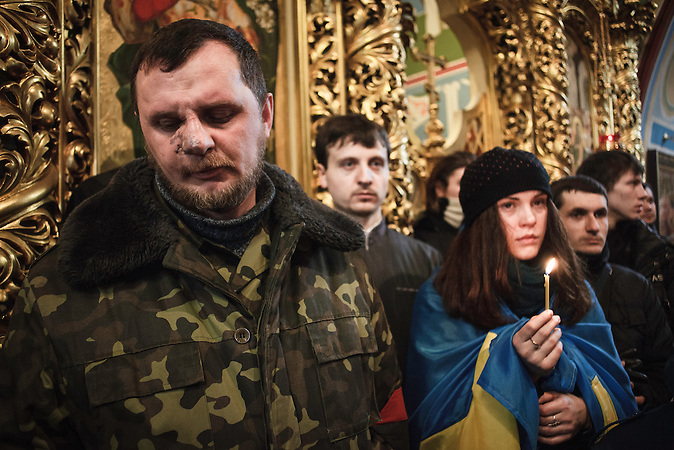 Trauerfeier Michail Schisnewskis, eines der Todesopfer in Kiew in der Sankt-Michael-Kathedrale 26.01.2014 /  Funeral of one of the victims in Kiev 26.01.2014