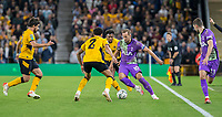 22nd September 2021; Molineux Stadium, Wolverhampton,  West Midlands, England; EFL Cup football, Wolverhampton Wanderers versus Tottenham Hotspur; Harry Kane of Tottenham Hotspurs changes direction with the ball at his feet to get past Ki Jana Hoever of Wolverhampton Wanderers