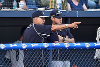 New York Yankees special assistant to the general manager Reggie Jackson with the coaching staff of the Charleston RiverDogs during a game against the Asheville Tourists on June 13, 2015 in Asheville, North Carolina. The Tourists defeated the RiverDogs 10-6. (Tony Farlow/Four Seam Images)