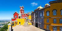 Famous, colorful Pena Palace, UNESCO World Heritage site with the empty Arches Yard, the chapel, and the clocktower, in Cintra, Portugal