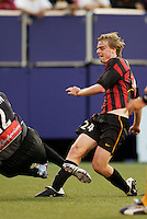 The Galaxy's goalkeeper Kevin Hartman tries in vain to block the shot of the MetroStars' Eddie Gaven as he scores his team's second goal. The NY/NJ MetroStars defeated the LA Galaxy 3 to 0 during MLS action at Giant's Stadium, East Rutherford, NJ, on August 8, 2004.