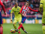 Sergio Mora Sanchez (L) of Getafe CF fights for the ball with Antoine Griezmann of Atletico de Madrid during the La Liga 2017-18 match between Atletico de Madrid and Getafe CF at Wanda Metropolitano on January 06 2018 in Madrid, Spain. Photo by Diego Gonzalez / Power Sport Images