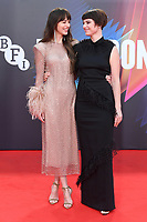 """**North America Only***<br /> <br /> Dakota Johnson and Jessie Buckley attend """"The Lost Daughter"""" UK Premiere at The Royal Festival Hall during the 65th BFI London Film Festival in London.<br /> <br /> OCTOBER 13th 2021<br /> <br /> Credit: Matrix / MediaPunch"""