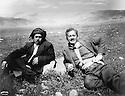 Iraq 1957 .Sheikh Marouf barzinji in a field with , left, a Turkoman friend .Irak 1957.Sheikh Marouf Barzinji avec un ami turkmene a gauche
