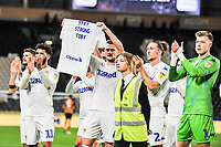 Leeds United players in front of the away fans during the Sky Bet Championship match between Hull City and Leeds United at the KC Stadium, Kingston upon Hull, England on 2 October 2018. Photo by Stephen Buckley/PRiME Media Images.