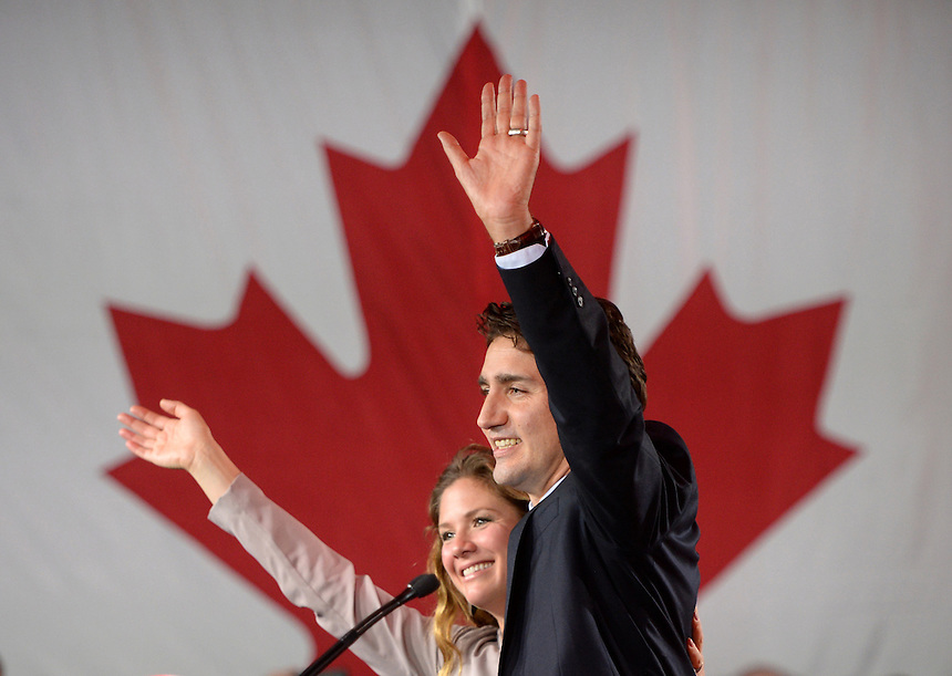 Liberal leader Justin Trudeau and wife Sophie Gregoire wave to the crowd after his speech at Liberal election headquarters in Montreal, Que. on Monday, October 20, 2015. THE CANADIAN PRESS/Sean Kilpatrick