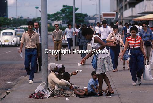 Brasilia Brazil South America. Poverty family  down town area begging. 1985 1980s
