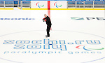 Sochi, RUSSIA - Mar 1 2014 -  Assistant Coach Curtis Hunt poses at centre ice before the team's first practice before the 2014 Paralympics in Sochi, Russia.  (Photo: Matthew Murnaghan/Canadian Paralympic Committee)