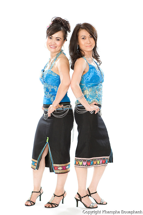 Leutvilay Temphrachanh, left, and Chanthaly Tan pose during the Lao New Year celebration at Wat Lao Thepnimith in Fort Worth on April 24, 2010.  (photo by Khampha Bouaphanh)