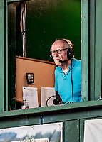 12 June 2021: Play-by-Play announcer George Commo looks out from the broadcast booth, calling a game between the Westfield Starfires and the Vermont Lake Monsters at Centennial Field in Burlington, Vermont. The Lake Monsters defeated the Starfires 4-1 at Centennial Field, in Burlington, Vermont. Mandatory Credit: Ed Wolfstein Photo *** RAW (NEF) Image File Available ***