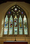 Church of St Thomas. Bradwell on Sea Essex England. 2009. Stained glass window show St Cedd on right.