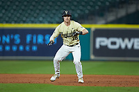 Pat DeMarco (18) of the Vanderbilt Commodores takes his lead off of first base against the Houston Cougars during game nine of the 2018 Shriners Hospitals for Children College Classic at Minute Maid Park on March 3, 2018 in Houston, Texas. The Commodores defeated the Cougars 9-4. (Brian Westerholt/Four Seam Images)