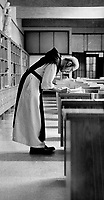 1983 FILE PHOTO - ARCHIVES -<br /> <br /> Full days: Between services; monks tend to tasks. A monk works in the book bindery (inset) while Brother David; above; transcribes religious scriptures, at Oka Monasterie<br /> <br /> PHOTO :  Mike Slaughter  - Toronto Star Archives - AQP