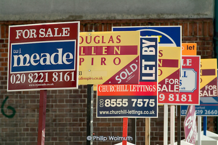Estate agents boards in Stratford, East London.