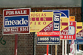 Estate agents boards in Stratford, East London.