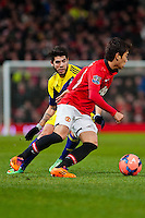 Sunday 05 January 2014<br /> Pictured:Shinji Kagawa puts the ball around the front of Alejandro Pozuelo of Swansea<br /> Re: Manchester Utd FC v Swansea City FA cup third round match at Old Trafford, Manchester