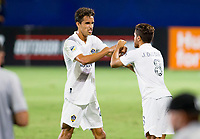 CARSON, CA - SEPTEMBER 06: Los Angeles Galaxy team mates Ethan Zubak #29 and Jonathan dos Santos #8 high five each other during a game between Los Angeles FC and Los Angeles Galaxy at Dignity Health Sports Park on September 06, 2020 in Carson, California.