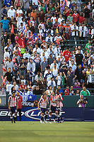 Chivas USA fans celebrate a goal with the players. Pachuca CF defeated the Chivas USA 2-1 during the 1st round of the 2008 SuperLiga at Home Depot Center stadium, in Carson, California on Sunday, July 13, 2008.
