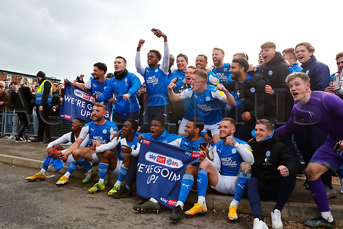 1st May 2021; Weston Homes Stadium, Peterborough, Cambridgeshire, England; English Football League One Football, Peterborough United versus Lincoln City; Peterborough United players celebrate outside The Weston Homes Stadium after Peterborough United win promotion to the EFL Championship