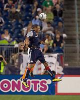New England Revolution forward Khano Smith (18) heads the ball. The New England Revolution defeated Houston Dynamo, 1-0, at Gillette Stadium on August 14, 2010.