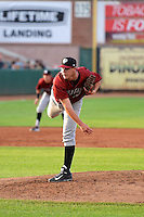 Jake Newberry (40) of the Idaho Falls Chukars delivers a pitch to the plate against the Ogden Raptors in Pioneer League action at Lindquist Field on July 26, 2014 in Ogden, Utah.  (Stephen Smith/Four Seam Images)