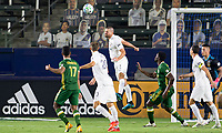 CARSON, CA - OCTOBER 07: Perry Kitchen #2 of the Los Angeles Galaxy clears a ball from the box with his head during a game between Portland Timbers and Los Angeles Galaxy at Dignity Heath Sports Park on October 07, 2020 in Carson, California.
