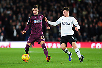 Bersant Celina of Swansea City battles with Mason Mount of Derby County during the Sky Bet Championship match between Derby City and Swansea City at the Pride Park Stadium in Derby, England, UK. Saturday 01 December 2018