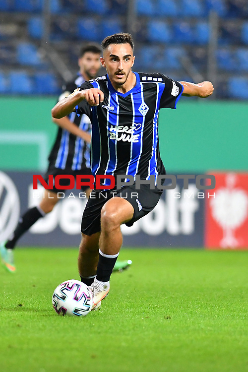 13.09.2020, Carl-Benz-Stadion, Mannheim, GER, DFB-Pokal, 1. Runde, SV Waldhof Mannheim vs. SC Freiburg, <br /> <br /> DFL REGULATIONS PROHIBIT ANY USE OF PHOTOGRAPHS AS IMAGE SEQUENCES AND/OR QUASI-VIDEO.<br /> <br /> im Bild: Onur Uenluefcifci (SV Waldhof Mannheim #7)<br /> <br /> Foto © nordphoto / Fabisch