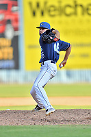 Asheville Tourists pitcher Braxton Lorenzini (26) delivers a pitch during game one of a double header against the Columbia Fireflies at McCormick Field on August 4, 2018 in Asheville, North Carolina. The Tourists defeated the Fireflies 5-1. (Tony Farlow/Four Seam Images)