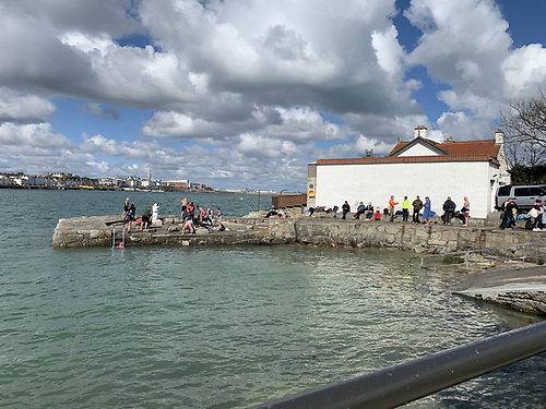 The scene at Sandycove Harbour in the South of Dublin Bay where sea swimming in the harbour and nearby Foot Foot is a year round pursuit Photo: Afloat