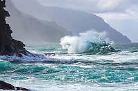 A powerful wave breaks towards Na Pali coastline, as seen from Ke'e Beach, North Kaua'i.
