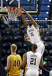 Nevada's D.J. Fenner dunks over Northwest Christian during a college basketball game in Reno, Nev., on Sunday, Dec. 28, 2014. Nevada won 81-67.<br /> Photo by Cathleen Allison