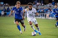 SAN JOSE, CA - MAY 15: Eryk Williamson #19 of the Portland Timbers is challenged for the ball by Jack Skahan #16 of the San Jose Earthquakes during a game between San Jose Earthquakes and Portland Timbers at PayPal Park on May 15, 2021 in San Jose, California.