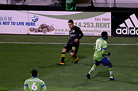 COLUMBUS, OH - DECEMBER 12: Lucas Zelarayan #10 of the Columbus Crew crosses the ball past Joevin Jones #33 of the Seattle Sounders FC during a game between Seattle Sounders FC and Columbus Crew at MAPFRE Stadium on December 12, 2020 in Columbus, Ohio.