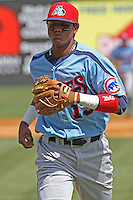 Starlin Castro #13 of the Tennessee Smokies running in from the infield during a game against the Carolina Mudcats on April 20, 2010  in Zebulon, NC.