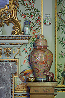A detail of a corner of one of the reception rooms demonstrates the extent of gilt embellishments that have been used in many of the rooms, already repleat with richly patterned and colourful surfaces